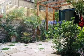 Garden With Trellis Creating A Courtyard Garden With Wall Bricks And Wooden Trellis