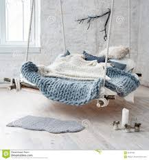 suspended bed white loft interior in classic scandinavian style hanging bed