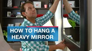 Hanging Pictures On Drywall by How To Hang A Heavy Mirror Or Picture Youtube