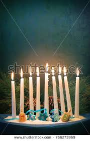 hanukkah menorah burning candles on table stock photo 161488784