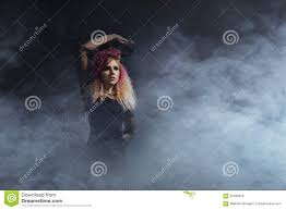 halloween background long witch in a blowing textile over the halloween background stock