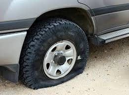 royalty free flat tire pictures images and stock photos istock