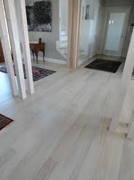 laminate grey wood floors with white wooden pillars as