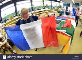 Flag Manufacturers Illustration An Illustrated Picture Shows An Employee Of Flag
