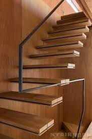 deck stair design attaching to the top of a landing offers a
