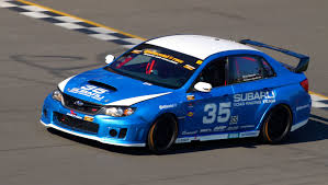 subaru mitsubishi subaru runs strong in grand am continental tire sports car