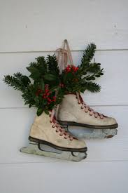 vintage ice skates as a front door ornament for the holidays a