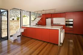 Picture Of Orange Kitchen Cabinets White Countertops Laminate - Orange kitchen cabinets