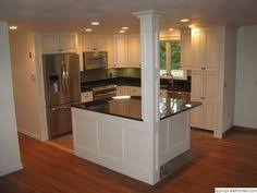 L Shaped Kitchen With Island Layout L Shaped Kitchen Layout With An Arched Overhang On The Island