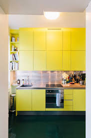 yellow painted kitchen cabinets divine yellow color small kitchen cabinets with grey color granite