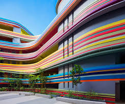 colorful building studio505 extends nanyang primary school in singapore