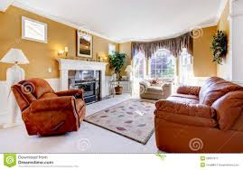 living room with cozy fireplace and leather couch stock photo