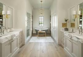 Hardwood Floors In Bathroom Pale Gray Washstands Facing Each Other Across From Pine Wood