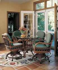 3100 antigua dining set with 4 caster swivel and tilt chairs from