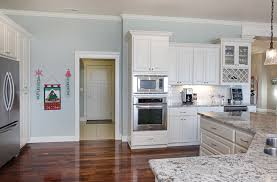 affordable custom cabinets showroom thumb kitchen traditional style painted raised panel angled island staggered height wine rack glass door bank