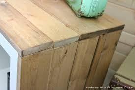 a plain white shelf with rustic charm aka an ikea kallax