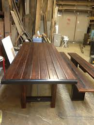 dining table and benches made from reclaimed wood and industrial