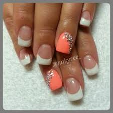 french manicure with diamonds on ring finger nail and accent of