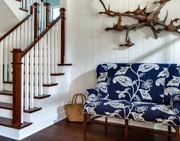 dining room dark stained wood stairs with handrail plus navy blue