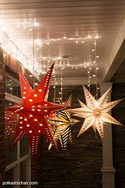 hanging star lanterns a christmas front porch decorating idea how to hang star luminaires on your front porch what a clever idea for decorating