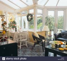 Black Wicker Furniture Black Wicker Chair And Leather Sofa In Conservatory Living And