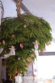 upside down christmas tree and traditional holiday decorations in