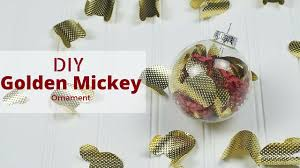 diy golden mickey ornament featuring golden mickeys from the