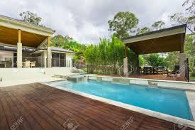 modern backyard swimming pool n mansion stock photo pictures on
