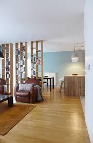 la cuisine lyon un salon séparé de sa salle à manger par une bibliothèque et de la