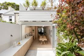 the kitchen in this house flows from inside to outside contemporist