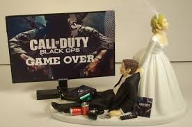 gamer wedding cake topper from 11 hilarious wedding cake toppers the daily meal