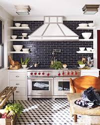 black tiled backsplash with geometric grey scale floor love this
