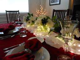 holiday table setting vases filled with