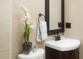 simplistic half bath ideas with espresso small vanity and wall