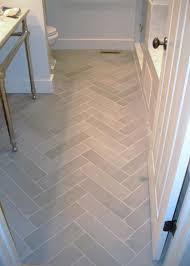 bathroom flooring light tile in herringbone pattern remodel
