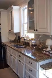 White Kitchen Cabinets With Black Granite Countertops Kitchen Backsplash With Black Granite Countertops And White