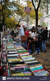 tables in central park strand bookstore outdoor sidewalk sales tables filled with books on