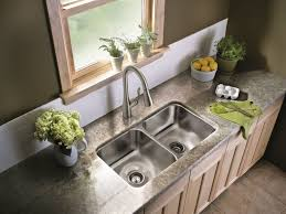 best kitchen faucets on the market kitchen chatters the moen 7594csl stainless high arc pulldown kitchen faucet fits this kitchen s finish perfectly