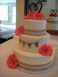 3 tier round wedding cake with burlap and lace trimming and silk