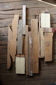 made reclaimed wood wall hanging by honeybadger woodworks llc