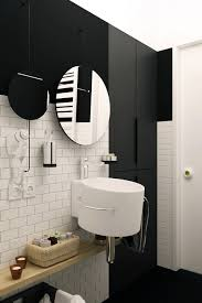 stylish use of mirrors in the bathroom with black and white