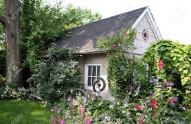 Small Cottage Small Cottage In Beautiful Garden Stock Photo Picture And Royalty