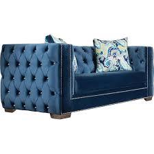 blue tufted tuxedo sofa