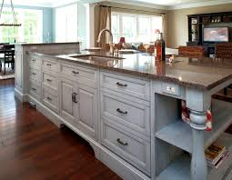 a large contemporary kitchen features a calcutta marble waterfall