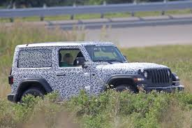 jeep spyshots 2018 jeep wrangler jl reveals grille and headlights