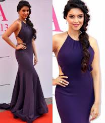 asin looks very pretty in this backless gown the halter neck full