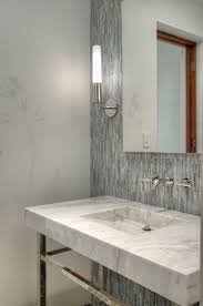 contemporary powder room with interior wallpaper by artistic tile