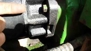 replacing a john deere 4450 starter nut problem youtube