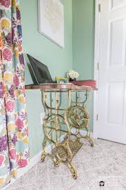 how to design a desk how to reuse the base of an antique sewing machine to create a