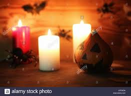 table decorations for halloween carved pumpkin head candles stock
